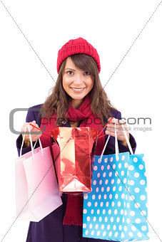Smiling brunette opening gift bag