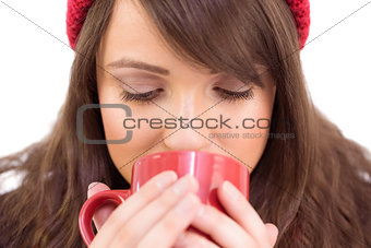 Close up of a festive brunette drinking from mug