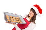 Brunette in santa hat offering hot cookies