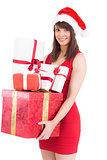 Festive brunette holding pile of gifts