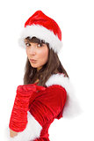 Pretty girl in santa costume holding hand out