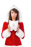 Sad festive woman holding a piggy bank in her hands