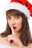 Festive brunette keeping a secret
