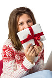 Festive brunette holding a gift with red ribbon