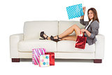Woman lying on couch with shopping bags