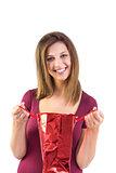 Festive brunette opening a gift bag