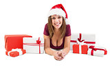 Festive brunette lying on the floor with many gifts
