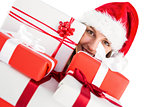 Close up of a festive young woman holding many gifts