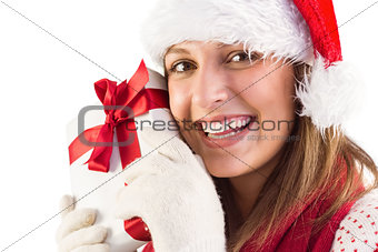 Portrait of smiling young woman holding gift