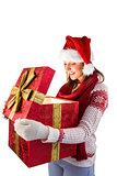 Young woman in stylish warm clothing opening a gift