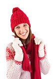 Smiling brunette in warm clothing looking at camera