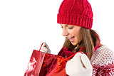 Shocked santa woman looking into shopping bag