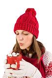 Festive girl blowing over mug