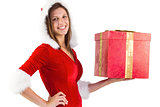 Festive brunette holding a gift