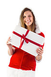 Pretty santa girl holding gift