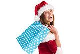 Festive brunette holding shopping bags