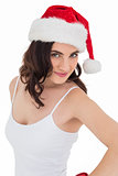 Portrait of a pretty brunette in santa hat