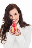Portrait of a brunette holding gild gift