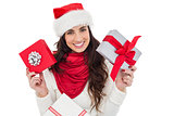 Happy brunette holding christmas gifts