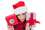 Cheerful brunette holding christmas gifts
