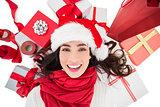 Festive brunette lying near christmas presents