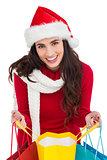Festive brunette opening shopping bag