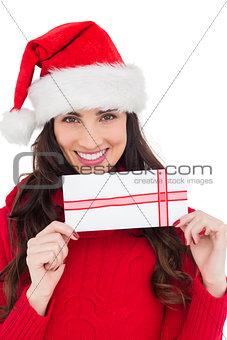 Smiling brunette holding a gift