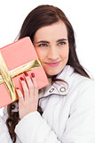 Portrait of a pretty brunette holding gift