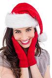 Portrait of a smiling brunette in santa hat