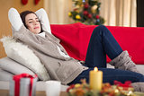 Brunette napping on the couch at christmas