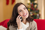 Smiling brunette on the phone on christmas day