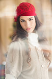 Portrait of a attractive brunette with red hat