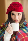 Brunette with cover holding mug