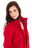 Portrait of a brunette in red coat posing