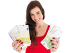Cheerful brunette showing her cash money