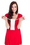 Stylish brunette in red dress holding shopping bag