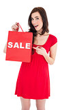 Stylish brunette in red dress showing sale bag