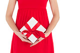 Woman in red dress holding gift