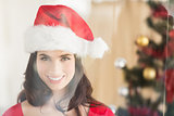 Festive brunette posing at christmas