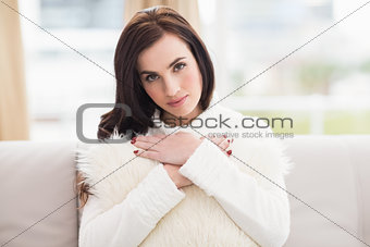 Beauty brunette holding a cushion