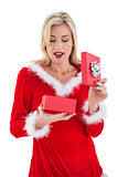 Festive blonde opening a gift