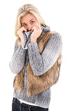 Blonde in winter clothes smiling at camera