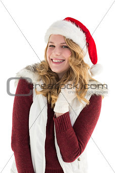 Blonde in santa hat smiling at camera