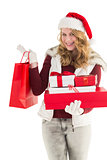 Festive blonde with shopping bag and gifts