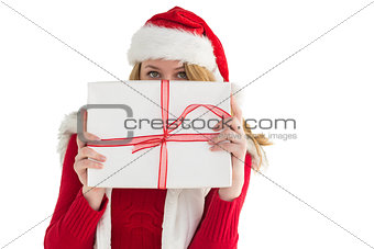 Blonde woman hiding behind a gift