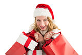 Girl in winter fashion holding presents and shopping bags