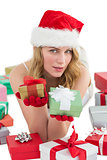 Woman in santa hat laying on the floor while holding gifts