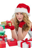 Pretty blonde looking at camera while holding a gift