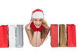 Smiling woman lying between shopping bags