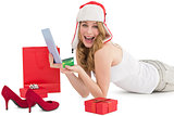Woman holding a credit card surrounded with gifts